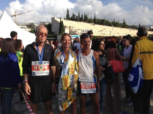 From left to right, my dad, me and our friend with our medals outside the stadium